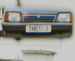 The car numberplate as seen in a mirror - looking like it spells out THE SEA