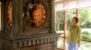 Maddy admires the clock in Antonia and Norman's living room