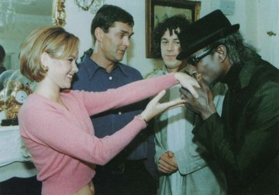 A publicity shot from the Problems at Gallows Gate, Hewie Harpwe is kissing the hand of Petra while Adam and Jonathan look on