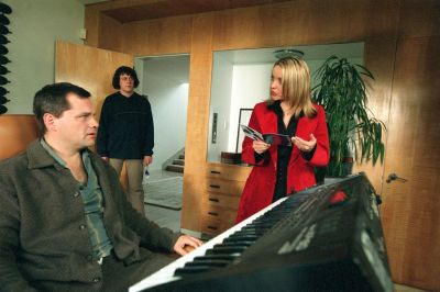 A publicity shot from Angel Hair, Carla and Jonathan meet Dudley in his studio