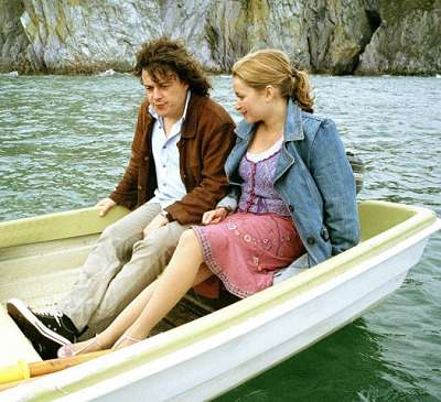 A publicity shot from The Seer of the Sands, Jonathan and Carla share a boat