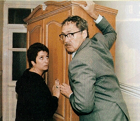 Publicity shot from The Reconstituted Corpse, Maddy with Sheldon moving a wardrobe